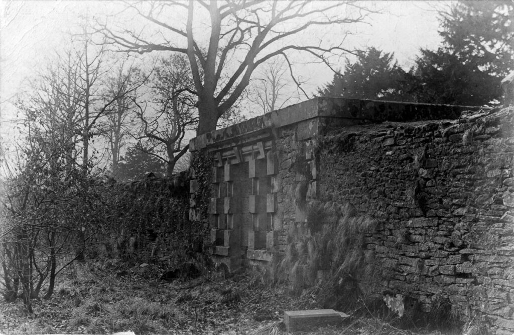 Black and white photograph of the remains of an 18th century tea pavilion near the Ladies Linn, taken in the early 20th-century