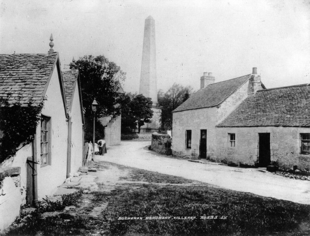 Black and white image of Killearn Square with Buchanan Monument in the background