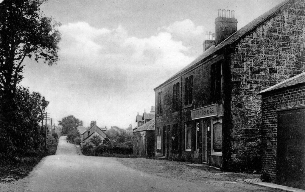 A black and white photograph of the road heading south from Killearn