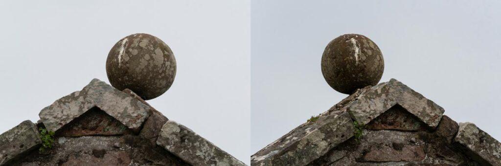 A stone ball balances precariously at the top of a church gable