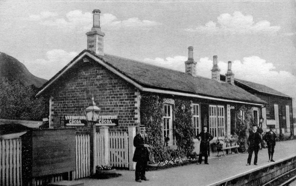 old black and white photo of people waiting on a station platform