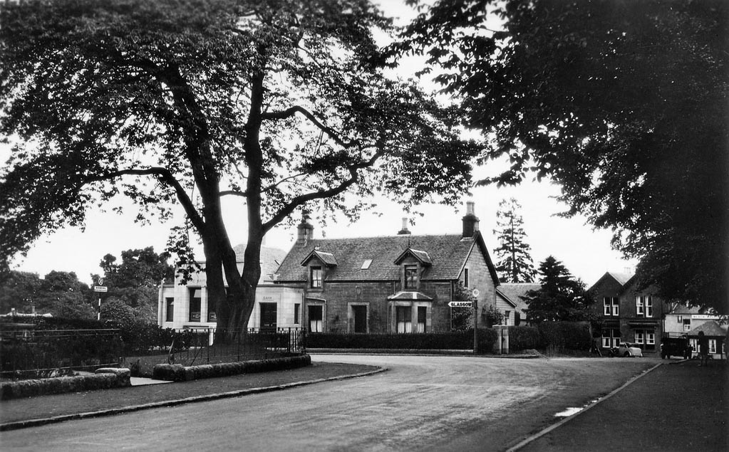 Black and white picture of buildings at the end of Killearn Main Street
