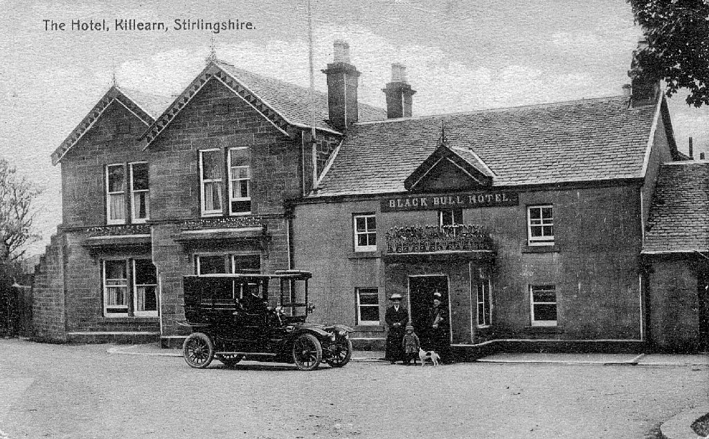 Black and white grainy photo of Black Bull Hotel in Killearn with guests and vintage car - 1912
