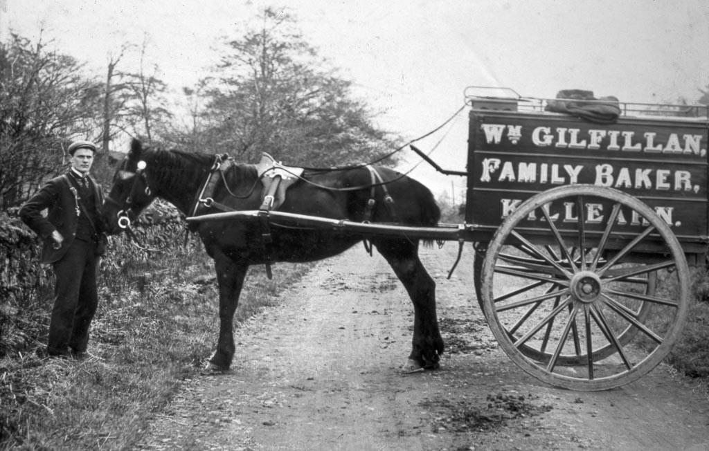 Black and white photo of Gilfillan's Bakers cart and driver in Killearn