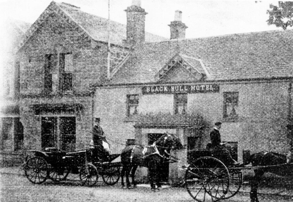 Black and white grainy photo of Black Bull Hotel in Killearn with horse drawn carriage outside