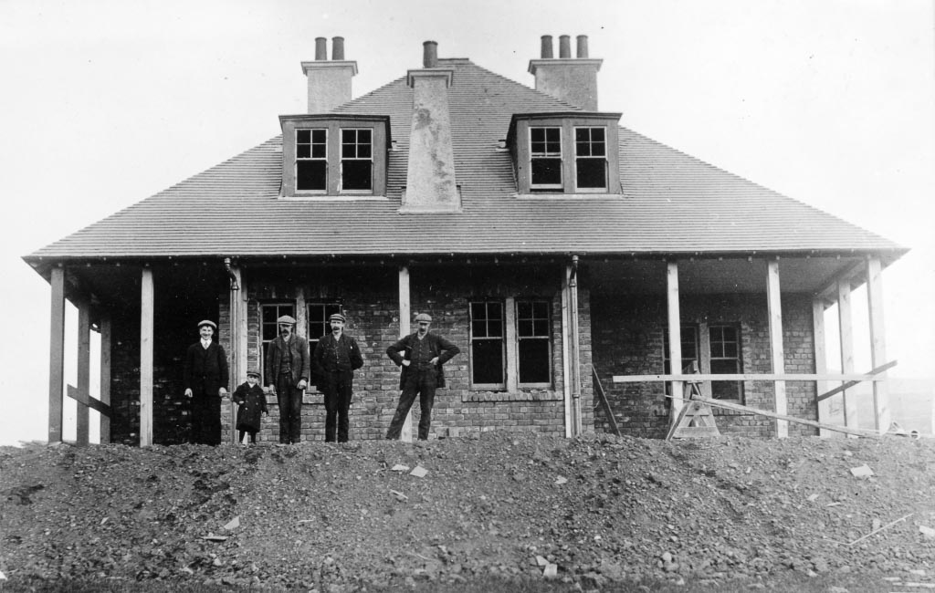 Black and white photo of Joiners working on a house in Killearn