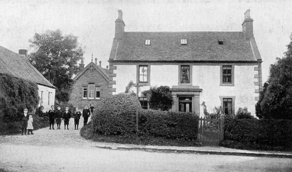 Black and white photo of Children outside Old Primary School and School House, Killearn