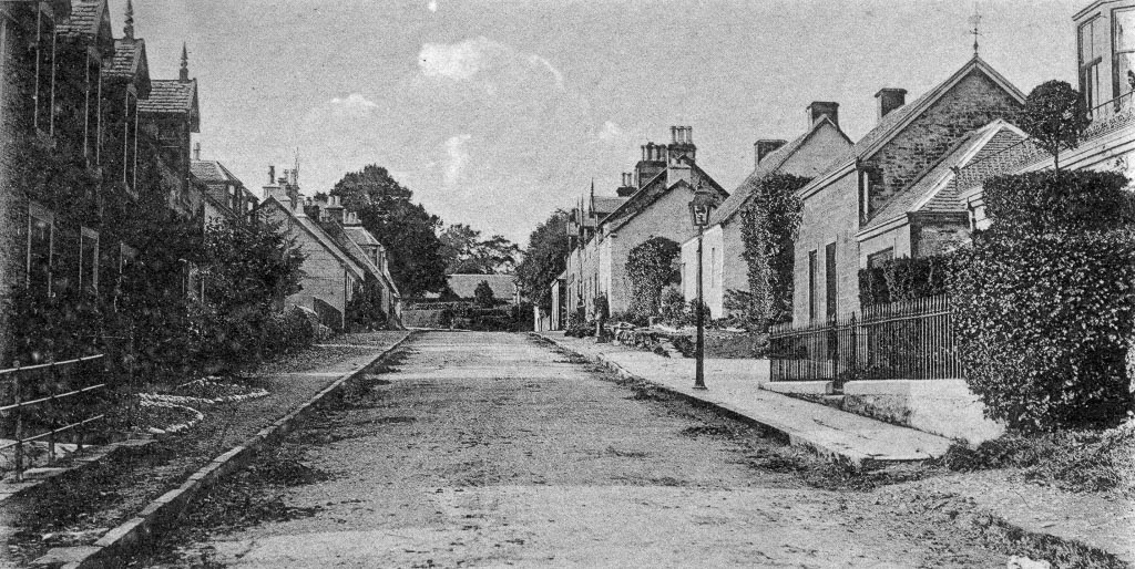 Black and white photo go the Mainstream view in Killearn with houses to both sides