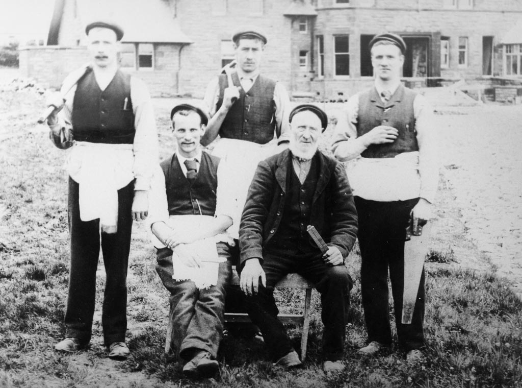 Black and white photo of joiners posing with tools