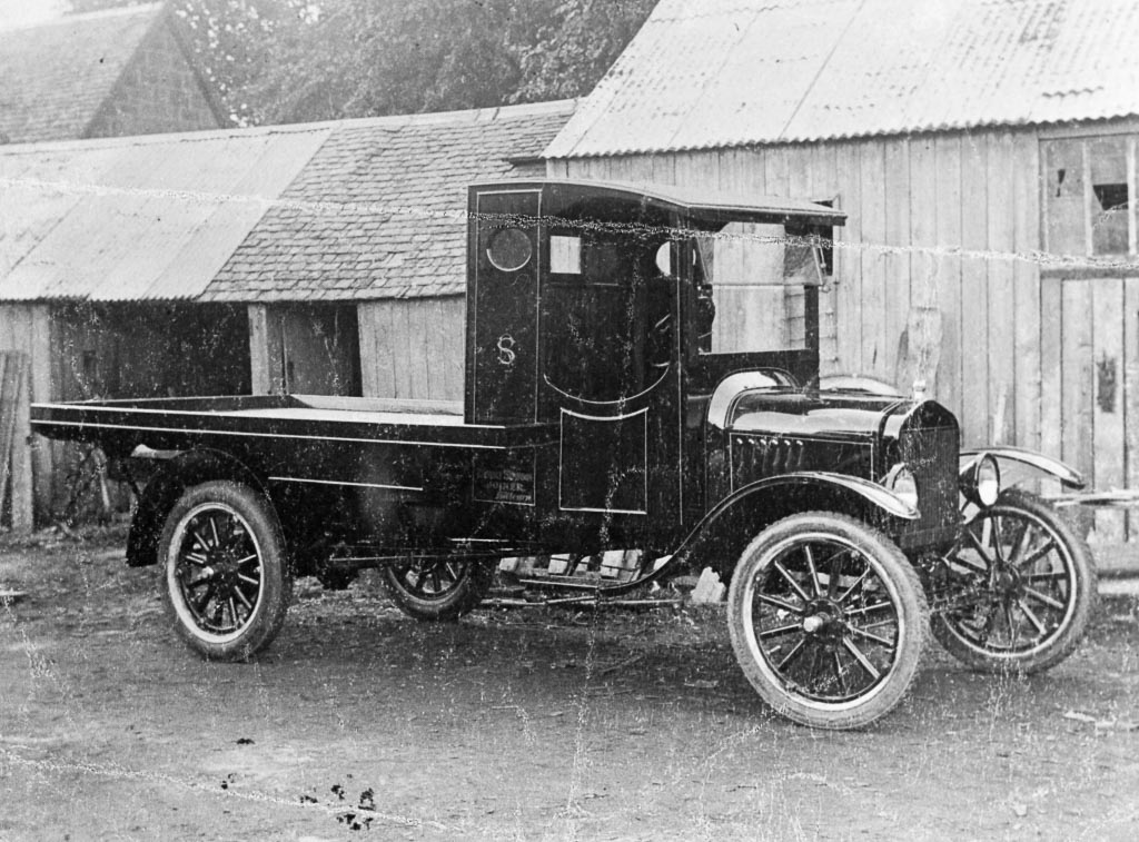 Black and white photo of Simpson's lorry in joiner's yard on Main Street, Killearn